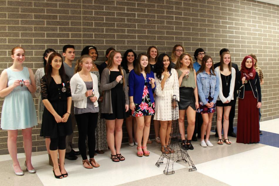 All+of+the+winners+smile+for+a+group+picture+taken+by+parents+and+teachers.+The+picture+was+taken+towards+the+end+of+the+banquet%2C+and+after+the+students+received+their+medals.