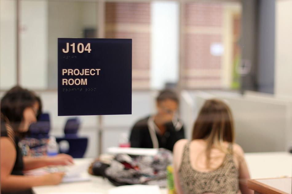 Students+in+Ms.+Allison+Peda%E2%80%99s%2C+English%2C+sixth+hour+English+11+course+work+in+the+new+project+rooms.+The+project+rooms+were+built+around+the+library+to+offer+students+more+room+to+work.