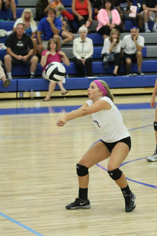 Mackenzie Evers (12) bumps the ball to a teammate. Evers played all three sets against Andrean.