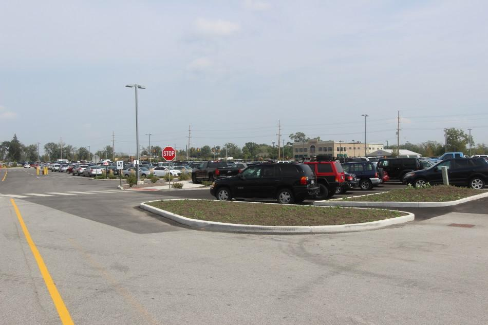The Red and Blue student parking lots are crowded during the school day.  Students have driven to school early in the morning to try and get a good parking spot.