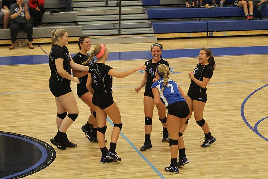The Lady Indians celebrate after winning the second set. They won the set with a score of 25-10.
