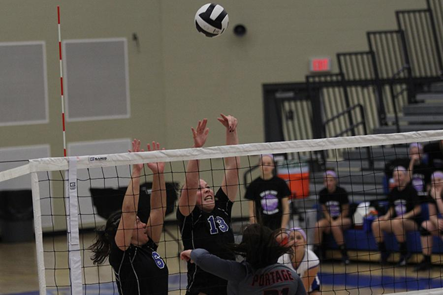 Stephanie+Spigolon+%2812%29+and+Nicole+Milaszewski+%2811%29+jump+up+to+block+the+volleyball.+The+ball+went+over+the+net%2C+but+Lake+Central+won+the+point.