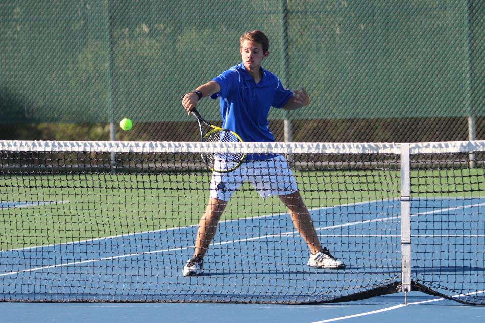 Brett+Balicki+%2812%29+attempts+to+hit+the+ball+over+the+net.+Balicki+had+a+great+match+and+won+both+of+his+sets.