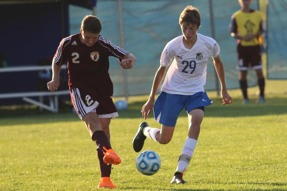 Alexander Reed (11) is about to kick the ball. Reed was able to take and maintain possession from Chesterton.