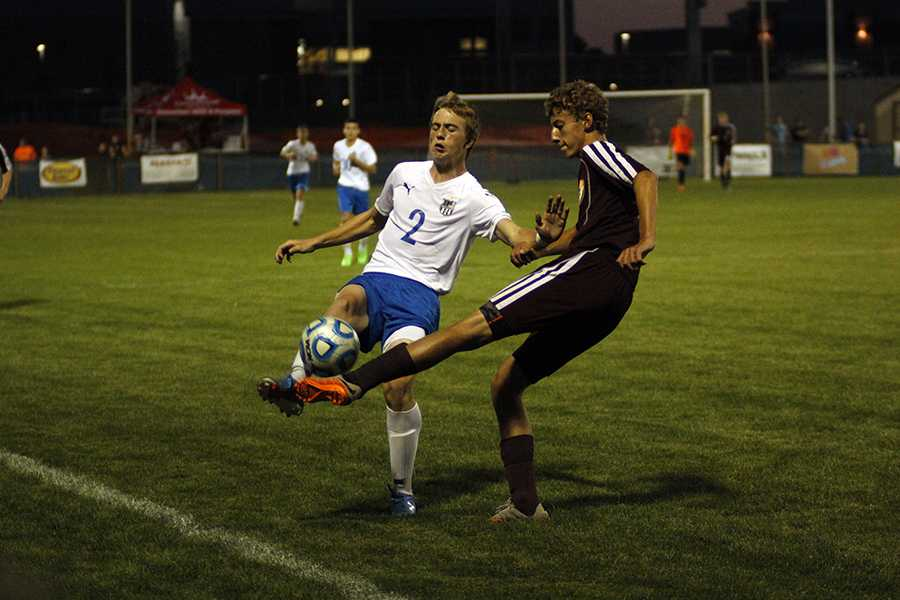 Cole Rainwater (9) competes with a Chesterton player for the ball during the game. The next game will take place on next Wednesday, Sept. 23 at Valparaiso.