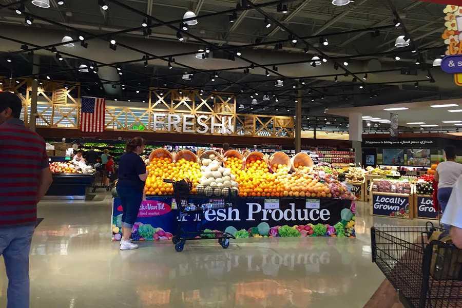 Stracks customers shop for fresh produce. The newly renovated store has increased their variety in organic produce.