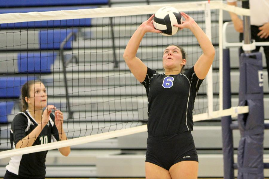 Stephanie Spigolon (12) sets the ball to the outside hitter. Spigolon played in all five sets against Valparaiso.