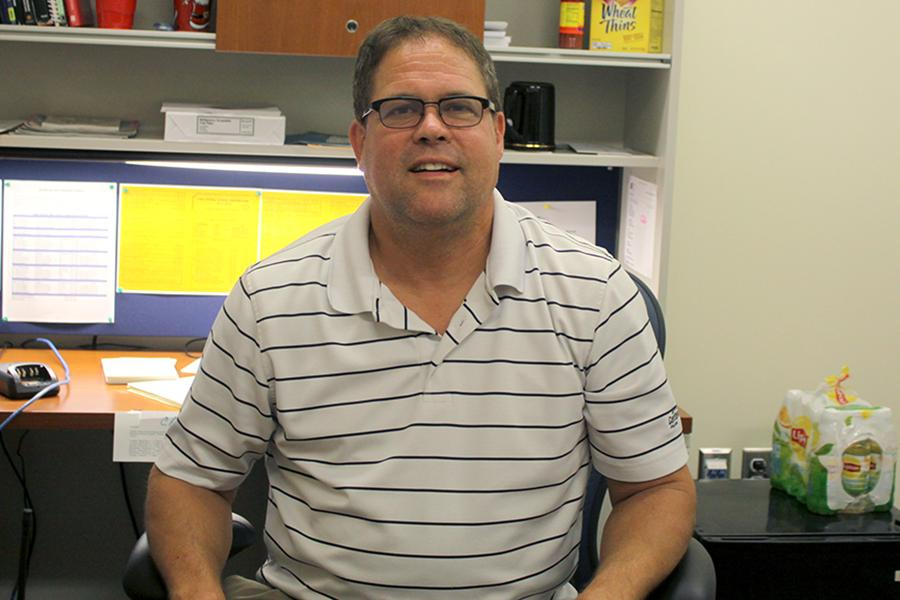 Mr.+Doug+McCallister%2C+Dean+of+Students%2C+is+sitting+at+his+new+desk+in+the+office.++This+year+he+began+his+new+position+as+Dean+of+Students.