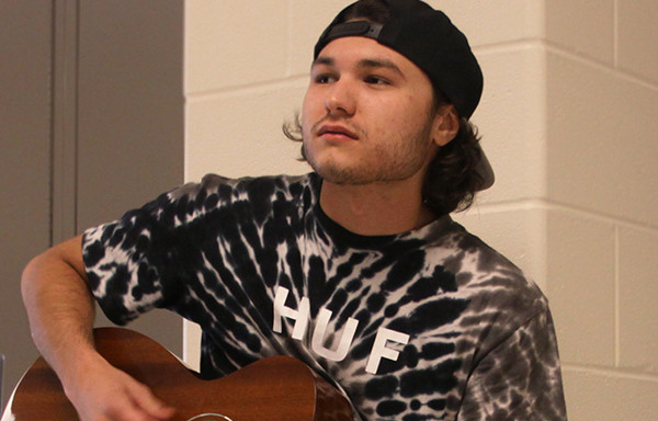 Sam Fioretti (12)  plays his guitar in the hallway at Lake Central High School.  Sam shared his plan to pursue his love of music by becoming a musician as a career.