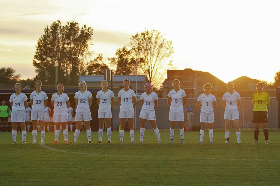 The varsity girls soccer team stands before the game. The team won 3-0.