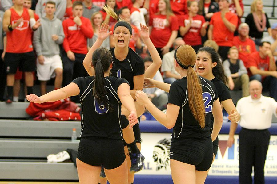 Victoria Gardenhire (12) celebrates after getting a kill. As an outside hitter, Gardenhire was a key offensive source for the Indians.