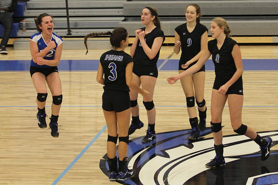 At the end of the game, Peyton Crnjak (9), Taylor Marten (9), Nicole Dubish (10), Rachel Furmanek (11) and Amanda Robards (9) jump up to celebrate. The girls beat the LaPorte Slicers two out of the three matches.
