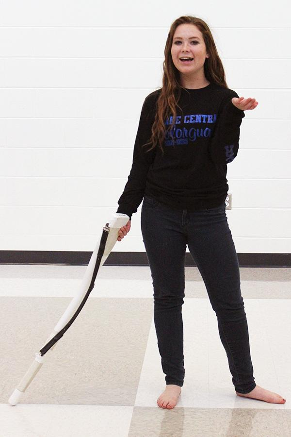Katie Palmer (12) poses with the rifle after tossing it in the air. Palmer has been on the color guard team every year she has been at Lake Central.