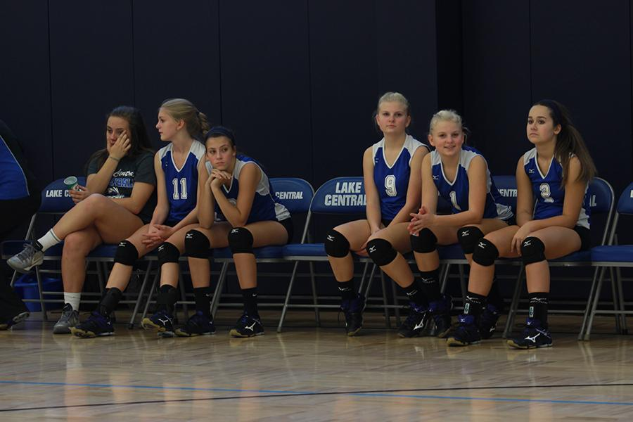 The+freshman+volleyball+team+waits+patiently+for+the+opposing+LaPorte+player+to+serve.+The+girls+won+the+match+2-0.