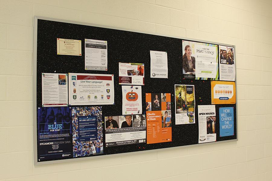 A+board+outside+of+the+guidance+office+displays+different+college+opportunities%2C+ranging+from+scholarships+to+visits.+Some+colleges+have+volunteered+to+send+representatives+to+the+Senior+Seminar+on+Oct.+14.+