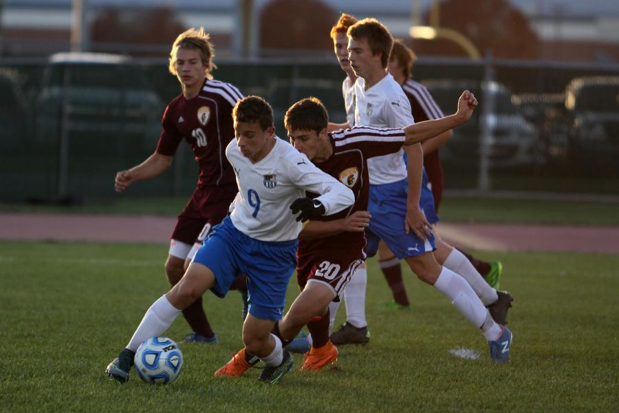 Chris Baranowski (11) protects the ball from the Trojans' defender.  Baranowki was one of the Indians' honorary captains for the game.