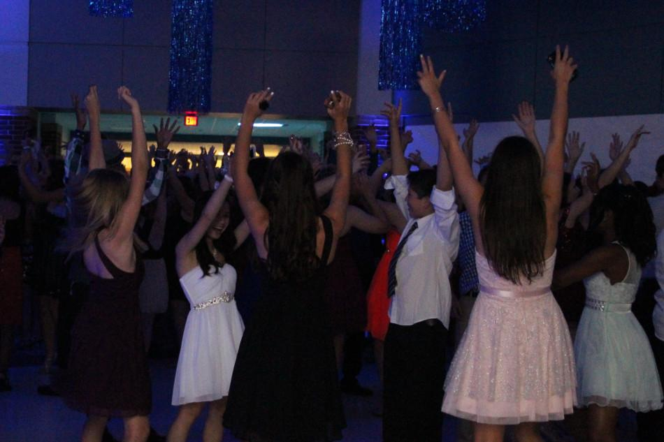 Students+throw+their+hands+up+for+the+photo.+A+large+majority+of+the+attendees+danced+to+this+song.
