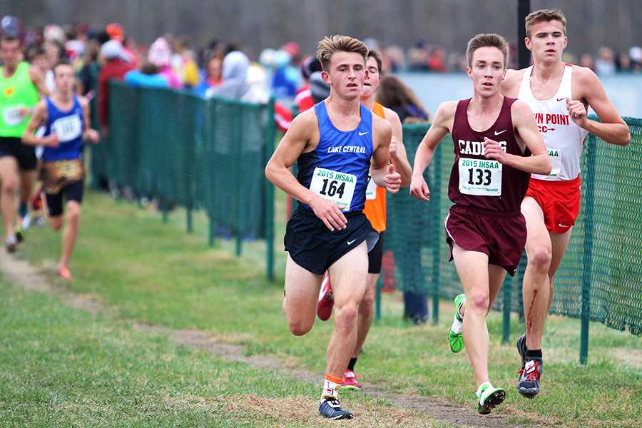 Kameron Konopasek (12) keeps his pace as he enters the fourth mile of the race. Konopasek finished in 17th place with a time of 15:47.3.