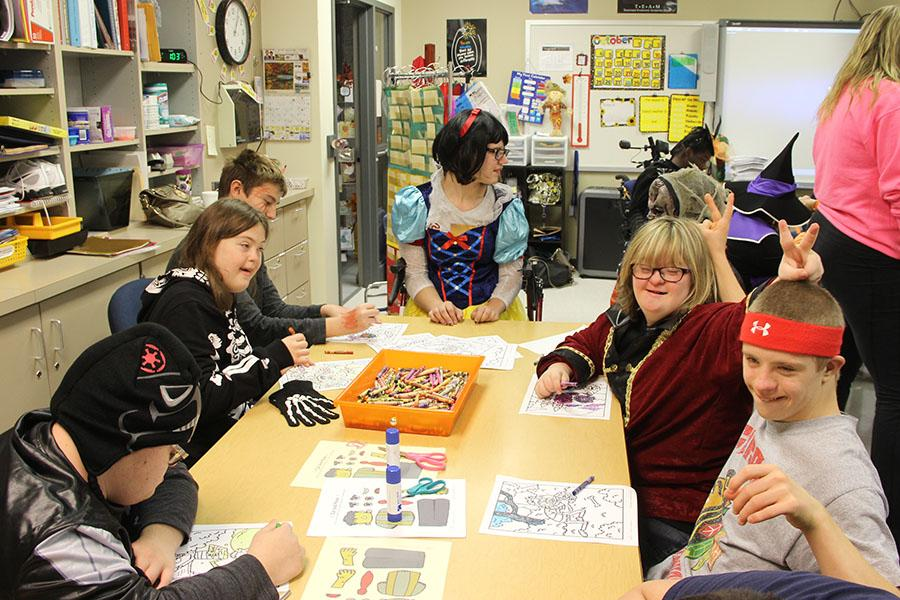Many of the students enjoy coloring Halloween pictures with each other. Those in attendance loved having extra fun time and loved being able to flaunt their costumes prior to Halloween.