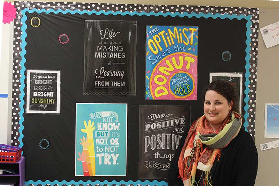 Ms. Janette Snelson, English, poses in her classroom. Ms. Snelson was selected to present two papers at the National Council of Teachers of English.