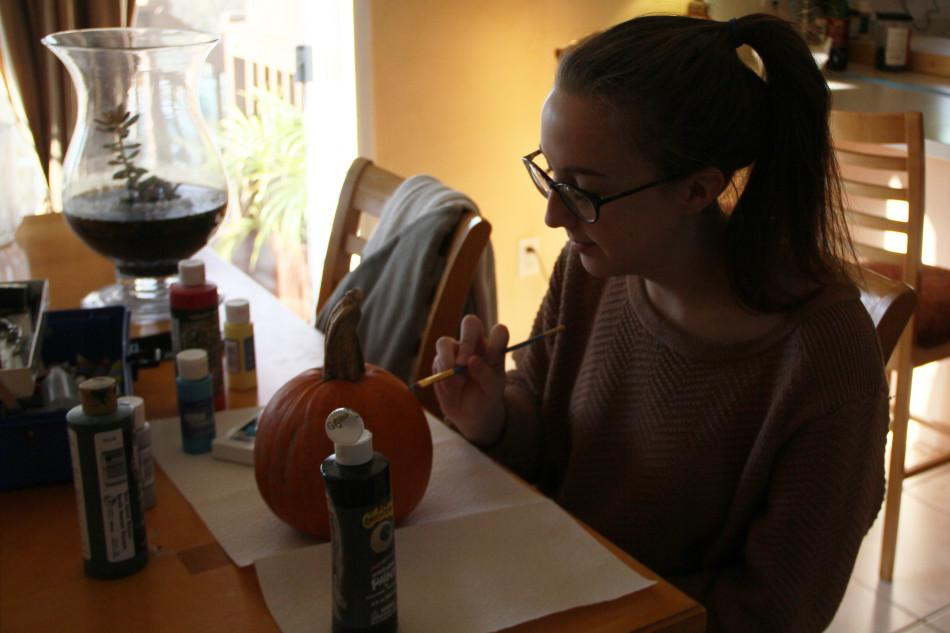 Gabriella+Goncher+%2812%29+paints+a+pumpkin.+Many+students+decorated+pumpkins+to+celebrate+Halloween.