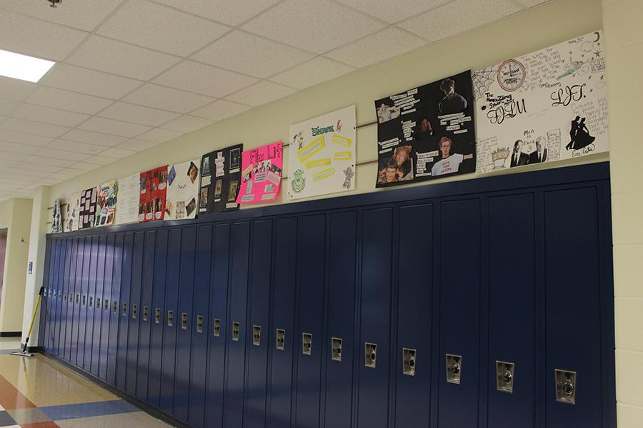 The+film+literature+students+finish+their+quote+posters+for+the+class.+They+were+hung+up+in+the+hallway+for+everybody+to+see.
