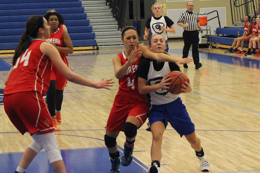 Lauren Ladowski (10) drives the ball to the hoop. The girls scrimmaged against Andrean on Nov. 4.