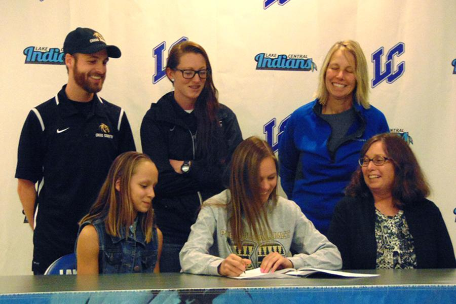 Emma Weissbeck (12) signs to Purdue University Calumet for cross country.  Throughout high school, Weissbeck has been a triathlete, participating in cross country, gymnastics and track and field.