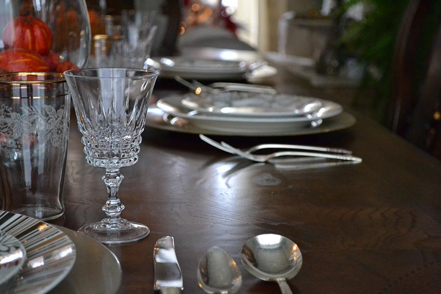 A+dining+room+table+is+set+for+Thanksgiving+dinner.+The+table+was+set+prior+to+Thanksgiving+to+make+more+time+to+spend+with+family+and+friends.