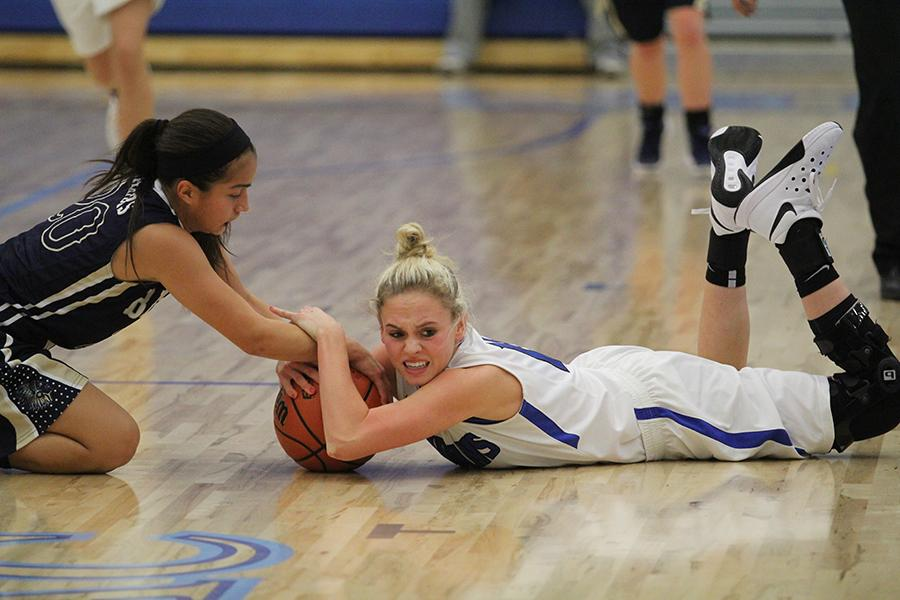 Rachel+Bell+%2812%29+fights+for+the+ball+against+Bishop+Noll.+The+aggression+was+very+big+with+this+game.
