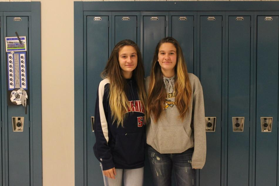 Bethany Adney (9) and Kristina Adney (9) pose for the camera on their second day at Lake Central. The girls transferred from Portage High School.