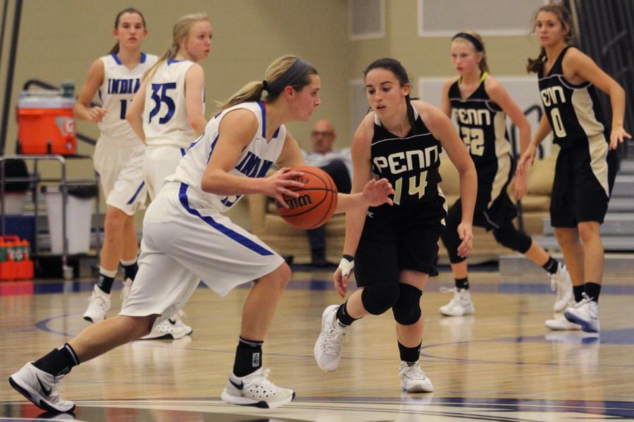 Meghan Long (9) tries to get past her opponent with the ball.  Long has been playing basketball since third grade.