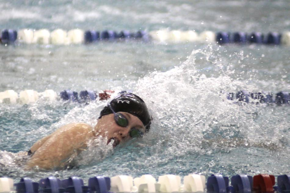 Jillian Murray (9) swims the 400 meter freestyle relay.  The varsity girls beat Valparaiso 109-76.