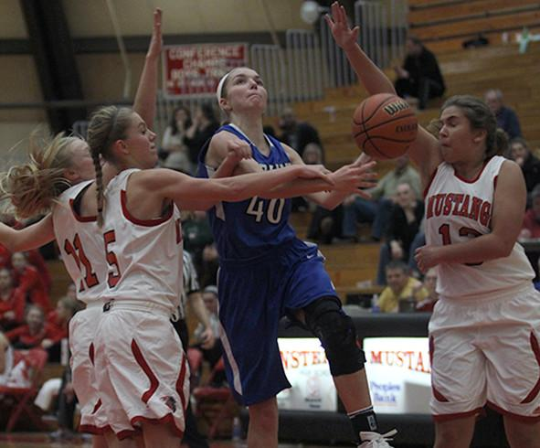 Kylie Fehrman (11) drives to the hoop. Fehrman has been a key player for the Lady Indians this season.