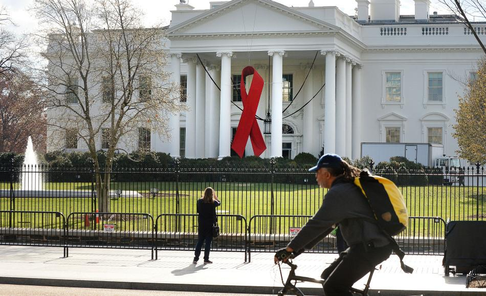 A red ribbon is displayed on the North Portico of the White House on Dec. 1, 2014, to commemorate World AIDS Day in Washington, D.C. Photo used with limited license: Olivier Douliery/Abaca Press/TNS