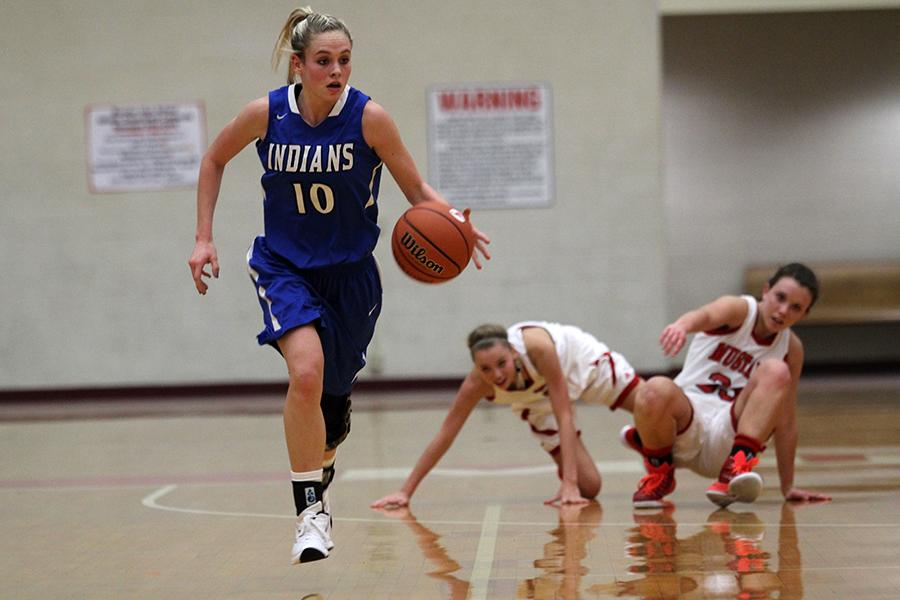 Rachel Bell (12) sprints down the court as Munster defenders fall behind. The Lady Indians beat Munster 79-33.