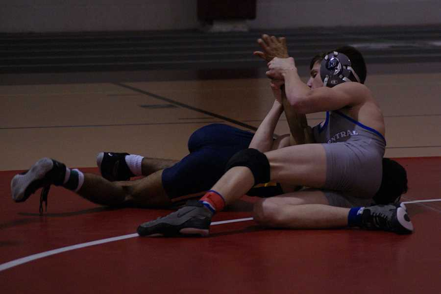 Maxwell King (11) holds his opponent on the floor in one of the first rounds of the tournament. The Indians took home two championship titles from the Lake County Wrestling Championship on Saturday, Jan. 9 at Hanover Central.