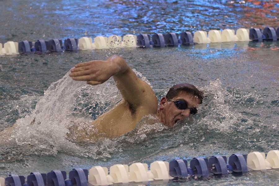 Alex Bielawski (12) sprints down the lane. The meet against Crown Point started at 5:30 p.m.