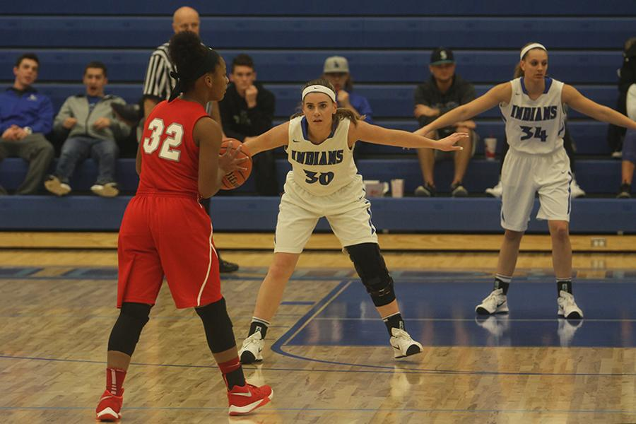 Alyssa Todd (12) locks down a Morton player. Todd shot two of 3 from the field and knocked in two free throws for a total of six points in the game.