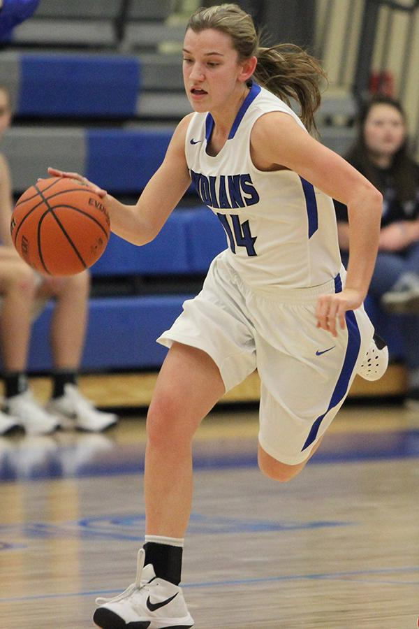 Cheyenne Mathas (10) dribbles the ball down the court. Mathas lead the team in strong defense against Morton.