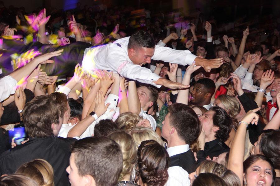 Formal King Nick Sambor (12) crowd surfs. Sambor was nominated for the 2016 Formal court.