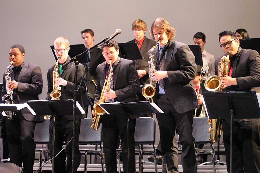 The saxophone section stands up during part of their jazz performance.  The Purdue Jazz Festival is considered to be Indiana's biggest jazz festival.