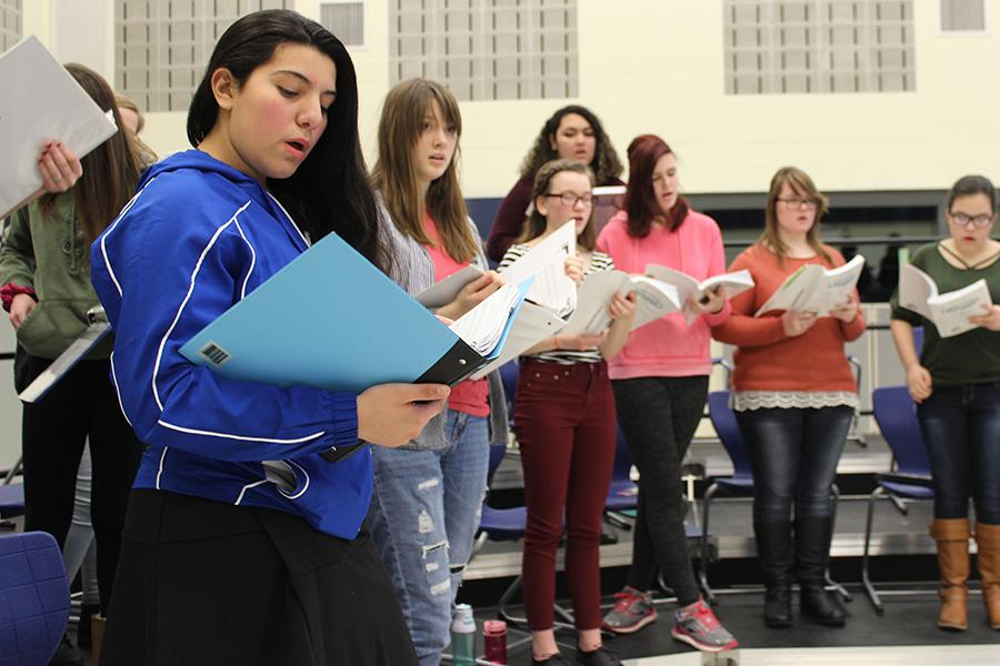 Miranda Munoz (9) sings with the chorus during practice. Each rehearsal, the actors practice their songs in the choir room.