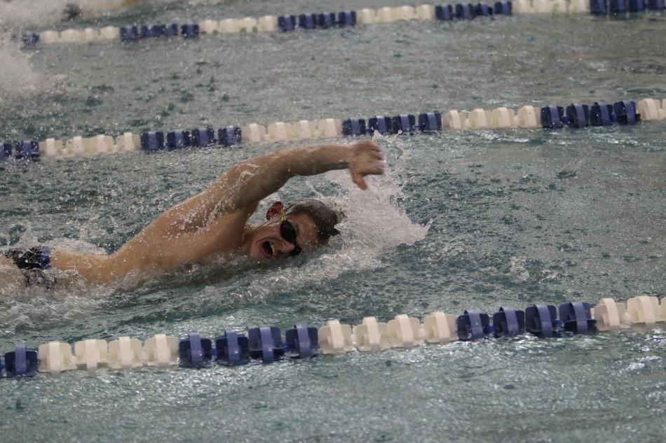 Brandon Walton (12) swims the 50 yard freestyle. Walton placed second in the race.