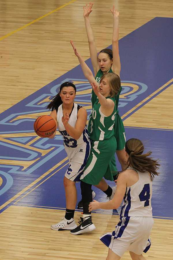 Alayna Hand (9) passes the ball to Alyssa White (9). By the end of the first half, the team was in the lead 18-11.