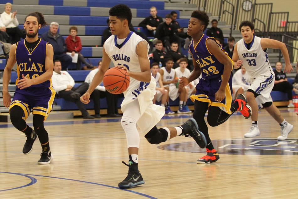 Keon Sellers (10) dribbles the ball down the court. The JV boys played against Clay High School on Saturday, Jan. 30.
