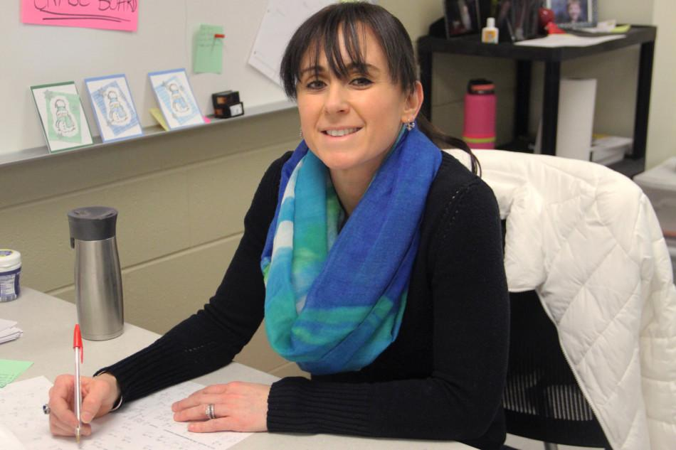 Mrs. Jill Zilz, Math, takes a break from grading papers. Mrs. Zilz is a new Geometry teacher at Lake Central.