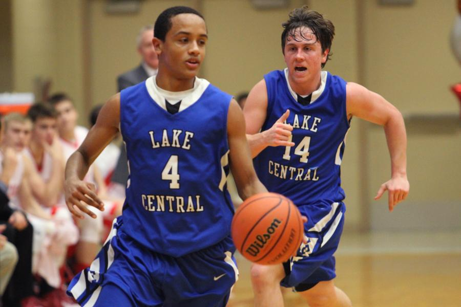 Joseph Graziano (11) and Skyler Smith (12) run through the court during the game's fourth period. The team lost the game 60-44.
