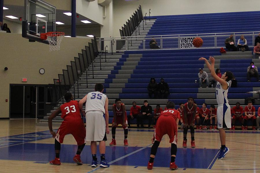 Dominic Ciapponi (9) makes a free throw shot during the first period. The game was held on Wednesday, Feb. 3.
