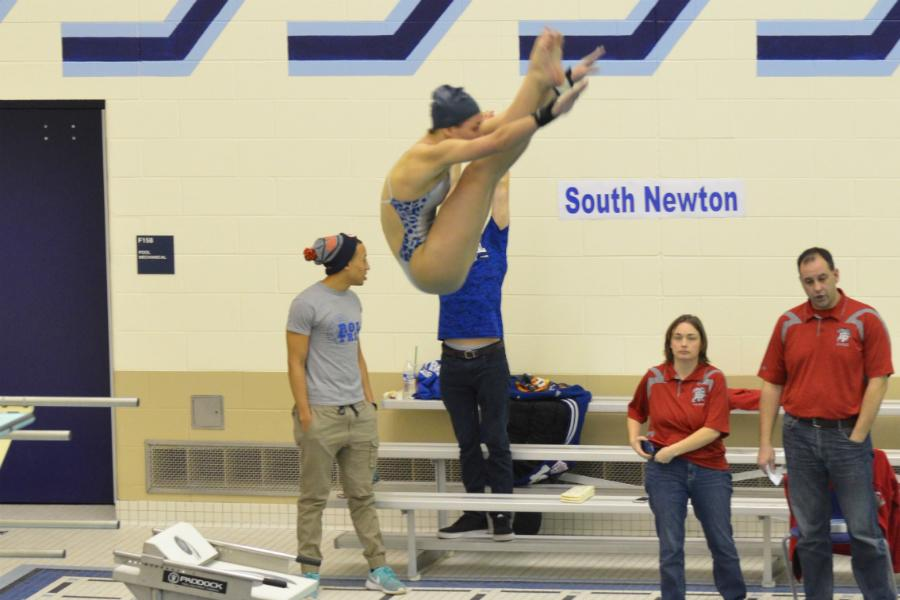 Kallie Higgins (11) performs her first dive of the prelims. Higgins received her highest score with this dive.